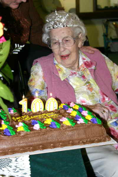by: Photo By Susan Matheny - Wilma Ramsey gets ready to blow out candles on her 100th birthday cake.