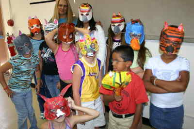 by: Photo By Susan Matheny - Debra Fisher, at back, with Madras Boys and Girls Club members after they completed their masks last week.