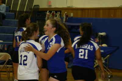 by: Photo By Gary Lindberg - Britney Lindgren (13) and Samantha Bland (12) celebrate Madras' five-game win against Bend.