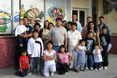by: Photo By Susan Matheny - La Cabanita owners Carmelo and Eulalia Burgos, at center, with their family.
