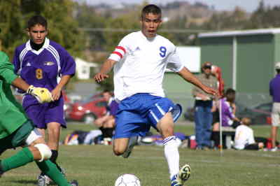 by: Photo By Gary Lindberg - Madras midfielder Jovany Medina was able to elude a Hermiston defender but not the keeper in the second half of Saturday's Intermountain Conference match. Medina did score a goal in the first half of the Buffs' 4-0 victory