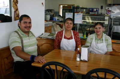 by: Photo By Susan Matheny - Mi Casa owners Noe Meigarejo and his sister Maria Escalente, sit at left, with Noe's wife Mercedes at right, who takes custome orders and runs the counter.