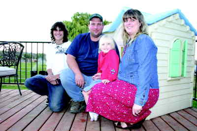 by: Photo By Holly Gill - The McCool family, from left, Adam McCary, 16, Dennis, Madison and Juanita McCool.