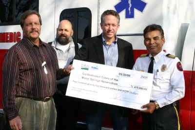 by: Photo By Holly Gill - From left, W.S. Tribal CFO Ray Potter, social services manager Rick Ribeiro, and Fire Chief Danny Martinez, at right, accept a grant check for $475,000 from USDA State Director Mark Simmons, second from right.