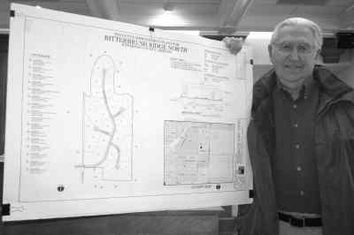 by: Photo By Susan Matheny - Gordon Shown with a map of his proposed subdivision addition.