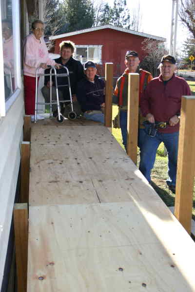 by: Photo By Susan Matheny - Nina Rosenbaum stands with volunteers who helped build her a wheelchair ramp. From left, Mark Mobley of Parr Lumber, which donated the materials, and builders Pete Post, Don Lehman and Gary Frazier.