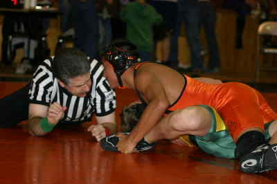 by: Photo By Gary Lindberg - After Culver's Miguel Baltazar locked up Tanner Conner of Colton in the second period, he looked to referee MIke Hawkins to see how close he was to a fall. Baltazar won the 130-pound title at the Culver Tournament, scoring pins in three of his matches.