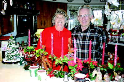 by: Photo By Susan Matheny - Frances and Dick Turner greet guests with treats in their festive holiday kitchen.