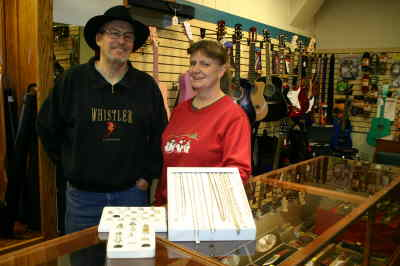 by: Photo By Susan Matheny - Bargain Hunters owners Ron Kellim and Sue Atkins with some of their bargains.