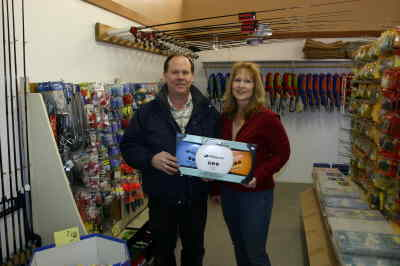by: Photo By Susan Matheny - Brad Lovrien and Deanna Jividen hold a Frisbee golf set at the shop.