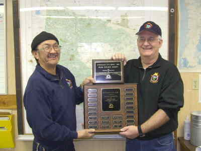 by: Submitted photo - Dispatcher Norman Lucei, left, and Ken Lydy, assistant fire management officer, display awards.
