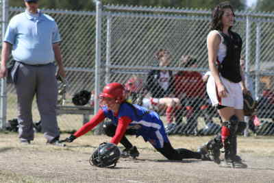by: Photo By Gary Lindberg - Danny Palmer crawls to home plate to score a run against Central in a game at the Sisters tuorney Friday as Central catcher Stacy Marinelli looks on. A day later, Palmer suffered a broken wrist while attempting to tag a Sisters runner.