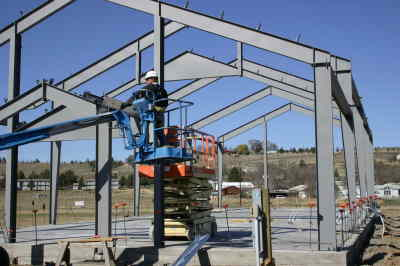 by: Photo By Susan Matheny - The Bullet Rentals building frame goes up.