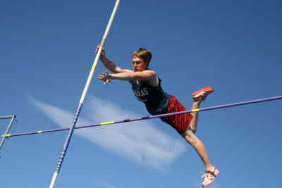 by: Photo By Gary Lindberg - With a wispy cloud in the background, Madras' Matt Bruck clears the pole vault bar during the White Buffalos' home Intermountain Conference dual meet against Crook County. Bruck cleared 10 feet to finish second.