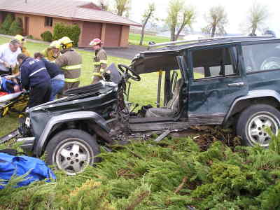 by: Oregon State Police photo - Fire department personnel used the Jaws of Life tool to extract the driver of the Jeep, above, after a two-vehicle accident on Saturday.