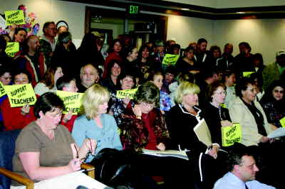 by: Photo By Susan Matheny - Over 100 teachers and other community members showed up at the Monday night school board meeting to weigh in on several issues.