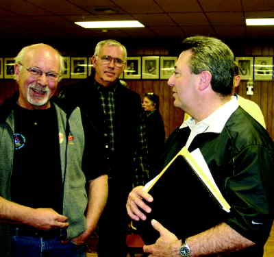 by: Photo By Holly M. Gill - Tom Brown, left, and Roy Hyder, center, discuss issues with state Sen. Ted Ferrioli at last Saturday's Town Hall at the Madras Elks Lodge.