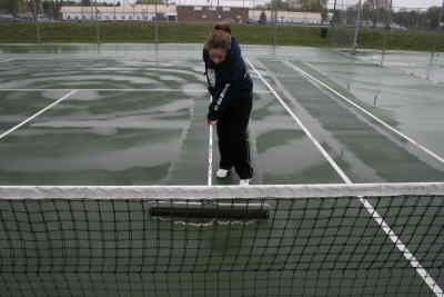 by: Photo By Gary Lindberg - Less than an hour after the Madras Invitational started, rain stopped play for 30 minutes. When the rain went away, Madras tennis player Paige Jorgensen was among several drying off the courts. Jorgensen and her partner, Addie Estimo, went on to win the second doubles category.