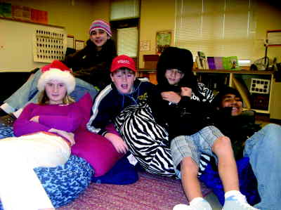 by: Photo By Debbie Lyons - Sixth graders who paid 50 cents to wear hats in school to raise money for Vernonia flood victims included, from left, Britni Jordan, Unity Ballord, Babe Stafford, Bolt Anglen and Juan Diaz.
