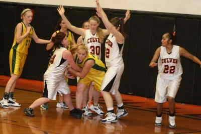 by: Photo By Gary Lindberg - A Gilchrist guard found life tough in the key against Culver defenders in the semifinal game of the Culver Holiday Tournament. Keeley Kinley  latched onto the ball while Kim Rufner (30) and Justine Parker (32) squeezed in as Gilchrist's Stephanie Thomas (21) and Culver's Maria Ruiz (22) looked on. The Bulldogs limited the Grizzlies to just 28 points.
