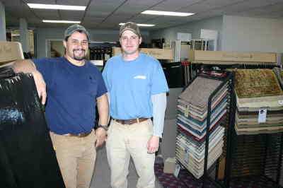 by: Photo By Susan Matheny - Juniper Ridge Floor Covering owners Shelby Adams, left, and Phillip Miller in the store's showroom.