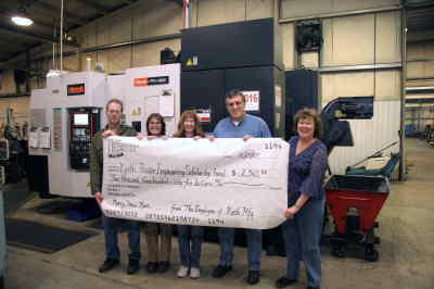 by: Submitted Photo - Keith employees with the donation check, from left, Jack Morris, Laura Crocker, Brenda Jones, president Mark Foster, and Berdi Wachter.