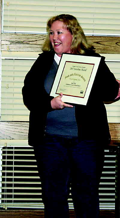 by: Photo By Susan Matheny - 509-J food service director Patti Jobe with her award.
