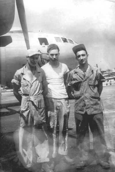 by: Family Photo - Tom Crow, at center, with two of his buddies from the 56th Air Depot Repair Squadron at Guam.