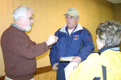 by: Photo By Holly M. Gill - Mike Morrissey, manager for Measure 37 and 49 for the DLCD, discusses Measure 37 claims with claimant Mark Hagman at an informational meeting Jan. 23 at the Jefferson County Fairgrounds.