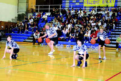 by: Photo By Gary Lindberg - The Culver Mini Dribblers perform at a Madras High basketball game in February.