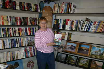 by: Photo By Susan Matheny - Marlys Miller inside the Shaniko Books 'N' More, which opened last Saturday.