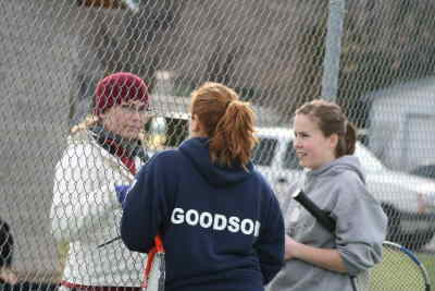 by: Photo By Gary Lindberg - Bundled up for cool spring day, Madras coach Julie Marino talks with No. 1 doubles team Amanda Goodson and Samanthan Blann during a break in the team's match against Bend.