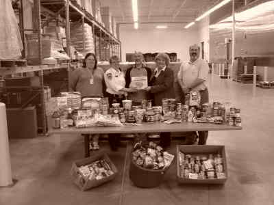 by: Submitted photo - Deer Ridge employees from left, Tami Ray (payroll), Cheryl Olson (food services), Sue Brabb (office specialist and food drive coordinator), and Randy Ross (business manager) flank Steve Murray, food bank administrator, holding donation at center.