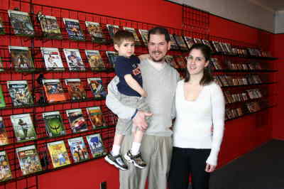 by: Photo By Susan Matheny - Jason and Rose Hagen with their son Dennis, 3, at the shop.