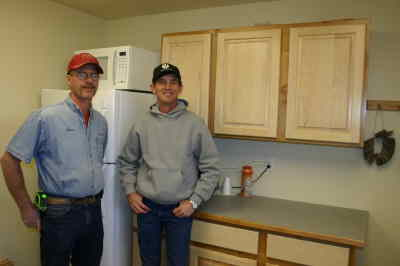 by: Photo By Susan Matheny - Cabinetmakers Lance Handsaker, left, and Larry Neal with some of their handiwork.