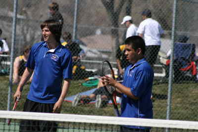 by: Photo By Gary Lindberg - Madras first doubles team of Skyler Sensibaugh (left) and Mervyn Garcia relfect after winning a match in the White Buffalo Invite. The Madras team won their division.