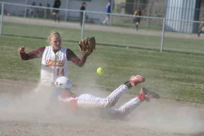 by: Photo By Gary Lindberg - Thanks to a hard slide, Madras' JoElla Smith was safe at second base when The Dalles-Wahtonka shortstop Cindy Garrett was unable to hang onto the ball. Smith had two hits including a triple but the visiting Eagle Indians won 10-7 in Thursday's game.