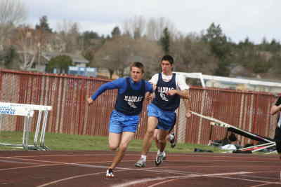 by: Photo By Gary Lindberg - Madras' final two legs of Jeremy Killoran (front) and Jed Ellenburg helped the Buffs win the 4x100 at the La Pine Invitational. Killoran also won the 100 with a lifetime best in Saturday's five-team meet.