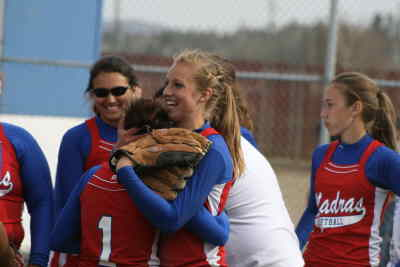 by: Photo By Gary Lindberg - After a long doubleheader against Pendleton, the Madras players had smiles of relief and victory Saturday. Reliever Maycee Abendschein (right) hugged center fielder Holly Martin while left fielder Oliva Parkins was all smiles as well. The Buffs defeated Pendleton by one run after losing in 11 innings. The split keeps Madras in the Intermountain Conference playoff race.