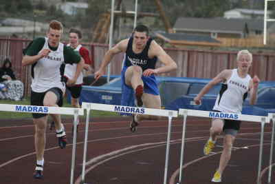 by: Photo By Gary Lindberg - In a two-race duel, Madras' Kelby Mills was able to edge Charlie Webb of Mountain View in the 300-meter hurdles in last Wednesday's Intermountain Conference meet. Earlier, Webb beat Mills in the 110 hurdles by a fraction of a second. The two will meet in a few weeks at the IMC district meet on May 16-17 at Mountain View High.