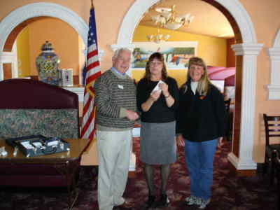 by: Submitted Photo - Rotarian Dick Anderson presents a check to Suzie Tignor and Debbie Aikens of the Culver schools special education program.
