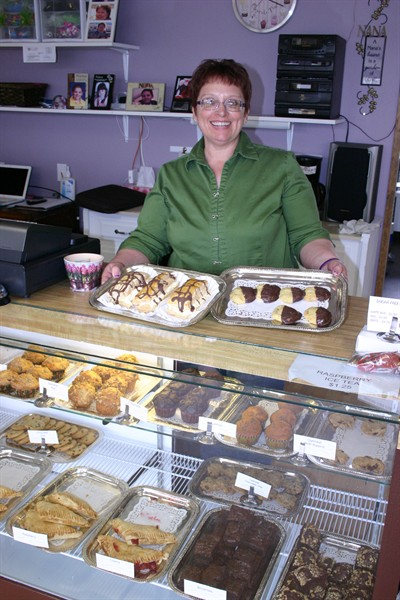 by: Photo By Susan Matheny - Nana's Sugar Free Bakery owner Kathey Johnston bakes fresh goodies every day.