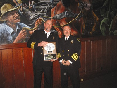 by: Submitted photo - CRR Fire Chief Tim McLaren, left, accepts award from Michael Kinkade, president of the Oregon Fire Instructors Association.