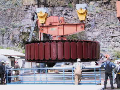 by: Contributed - The Round Butte Dam's modified 340-ton generator is shown here as it's lowered into the hydroelectric facility.
