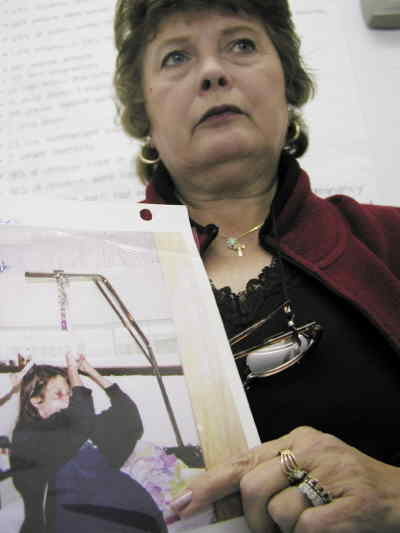 by: Photo By Troy Foster - Kathleen Piller shows a picture of her daughter shortly before she died of health problems related to her methamphetamine use. Piller now speaks to Jefferson County youth groups on the dangers associated with the prevalent drug.