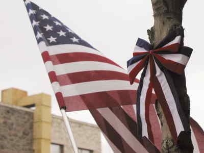 by: Photo By Tony Ahern - The Chamber of Commerce has placed patriotic ribbons throughout downtown in support of the troops.