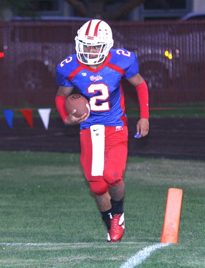 by: Photo By Joe McHaney - Madras High School junior running back Joe Hisatake rushed for three   touchdowns and 156 yards against visiting La Pine   Sept. 9.