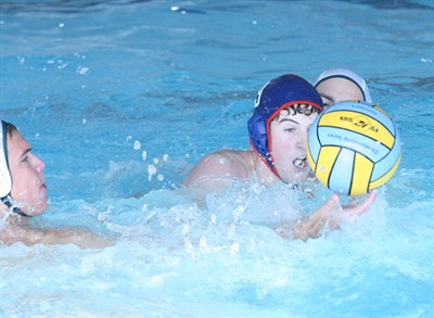 by: Photo By Joe McHaney - Madras' Aaron St. John competes for the ball Sept. 10 against visiting Summit during a boys water polo game.