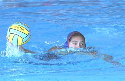 by: Photo By Joe McHaney - TaSheena George of Madras prepares to score Sept. 10, during a girls water polo game against visiting Summit at the Madras Aquatic Center.