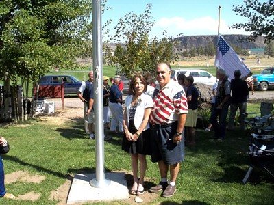 by: Photo by John Bowler - Raymond and Carolyn Barone, Ranch residents and owners of Rockwell American Services, donated a flagpole to the Ranch for the 9/11 memorial services.